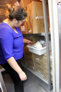 Excess food is stored in the freezer until King's Harvest volunteers arrive for bi-weekly pick-ups.